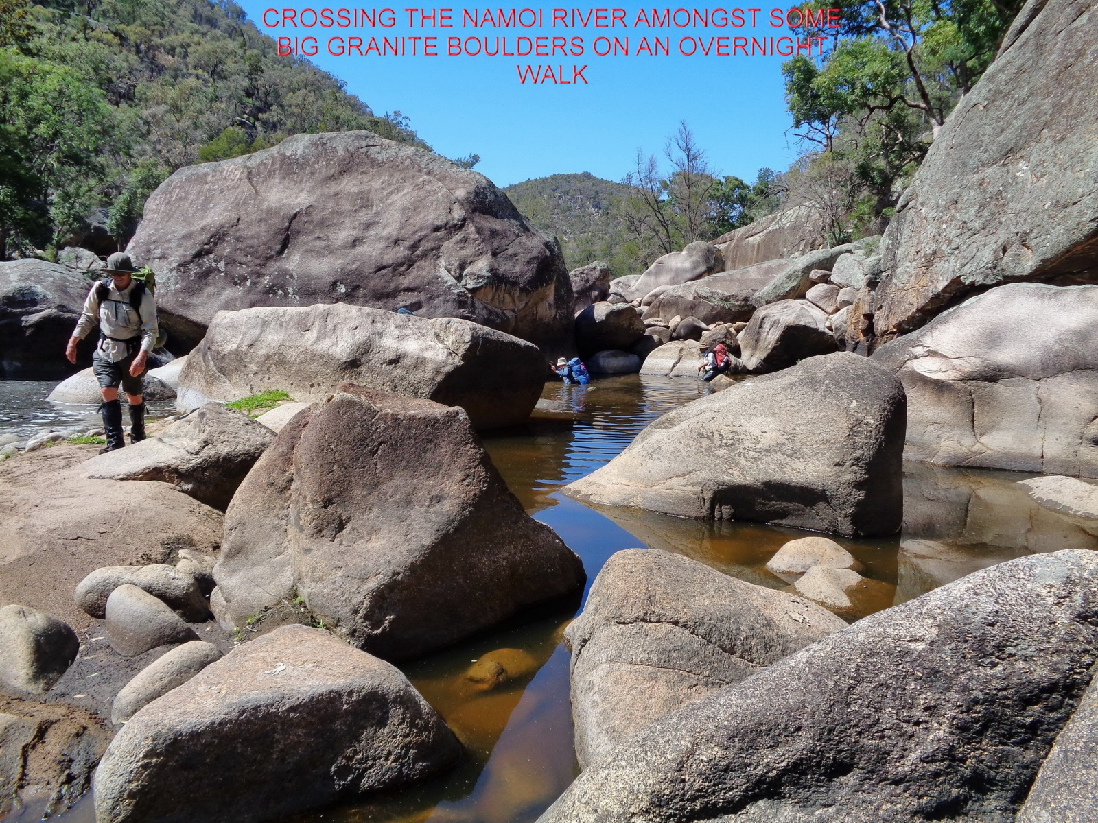 CROSSING THE NAMOI RIVER AMONGST SOME BIG GRANITE BOULDERS ON AN OVERNIGHT WALK