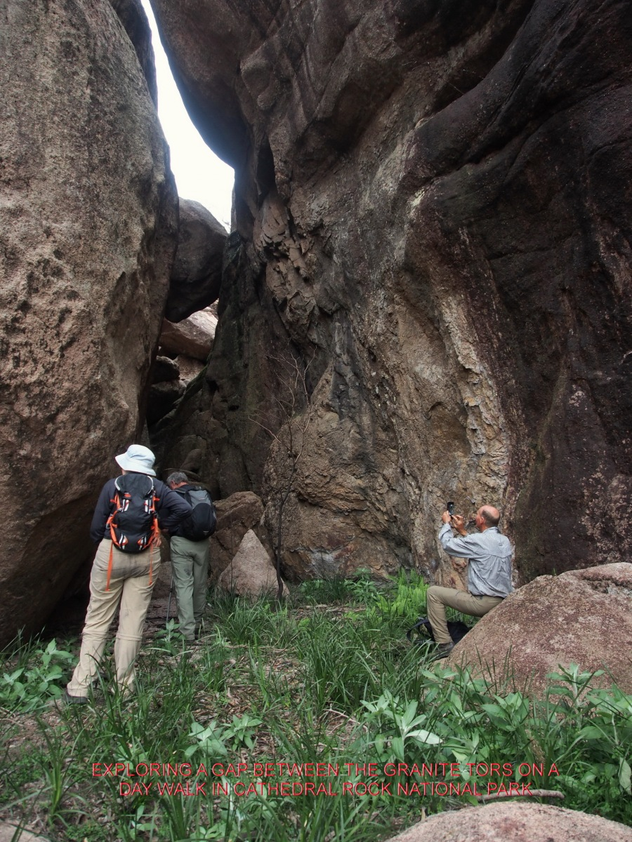 EXPLORING A GAP BETWEEN THE GRANITE TORS ON A DAY WALK IN CATHEDRAL ROCK NATIONAL PARK