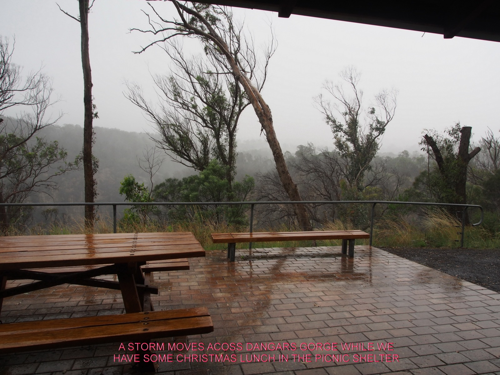 A STORM MOVES ACOSS DANGARS GORGE WHILE WE HAVE SOME CHRISTMAS LUNCH IN THE PICNIC SHELTER
